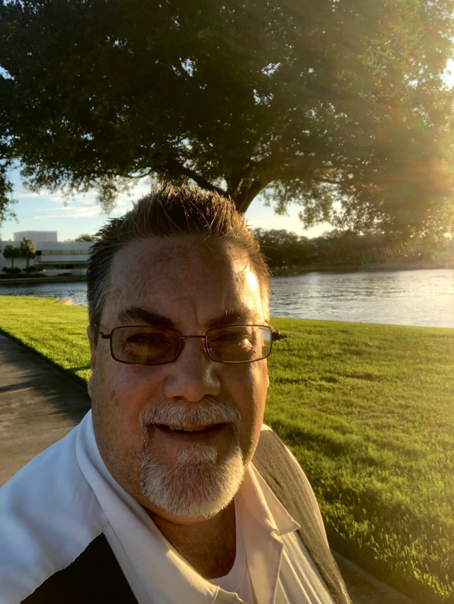 Photo of David Brodosi outside in the park.