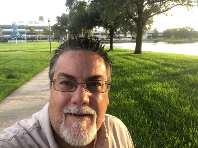 Photo of David Brodosi standing in park. A groundbreaker in higher education