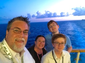 a photo of David Brodosi and family on a boat