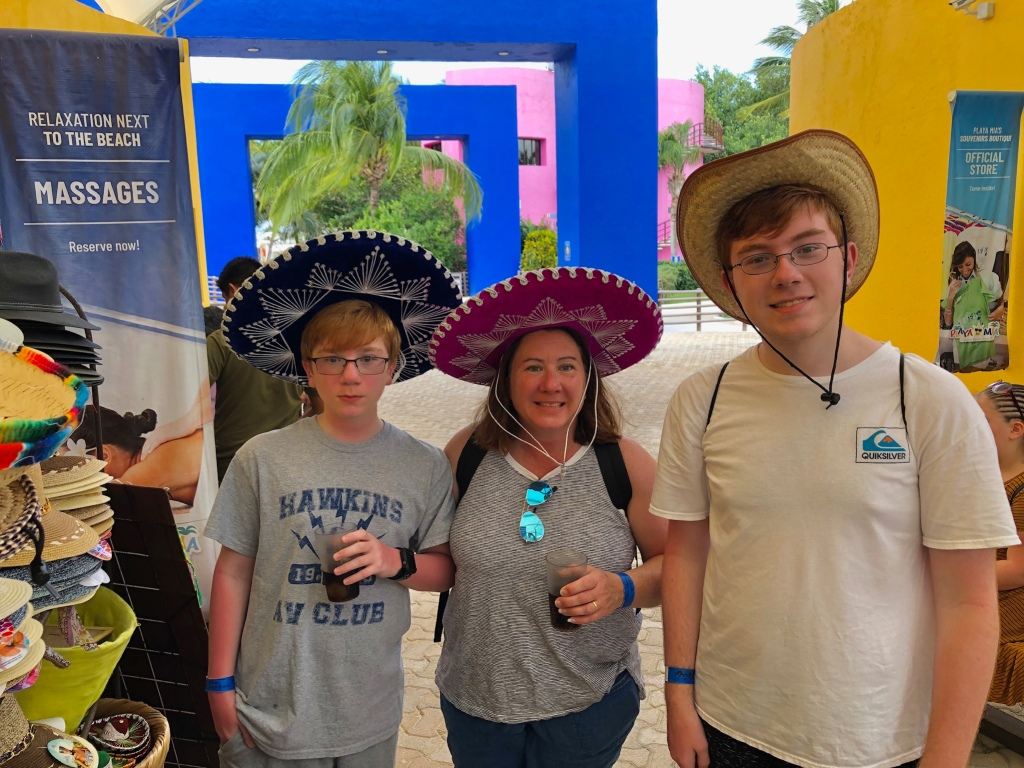 A photo of the brodosi family trying on different hats in Mexico
